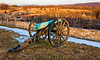 Evening light on a cannon and battlefields in Antietam National Battlefield, Maryland.