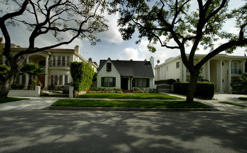 Original  homes are tucked in between Mansions off Oakhurst.   in Beverly Hills.