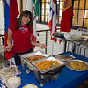 International Week coordinator and advisor to international students, Ms. Ramos prepares arroz con gandules y chuletas for students to get a taste of Puerto Rico.