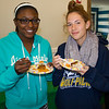 Bria Horseley '14 and Arianne Boisvert '14 get a taste of various cultures represented during International Week celebrations.
