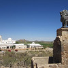 There is a hill on the Mission San Xavier del Bac property which contains a shrine and a path that circles around the hill to give good views of the valley. Two lions stand guard.