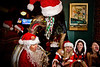 Tuba Santa at a table of Santarchists - 12-14-2013