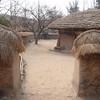 180_Korean Folk Village  Commoner's House in the Northern Part  Composed of several detached wings  Height is low and space small for preserving heat jpg