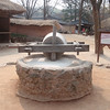 218_Korean Folk Village  Mill Stone  Was pulled by the livestock for hulling or pounding grains jpg