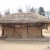 181_Korean Folk Village  Commoner's House in the Northern Part  Composed of several detached wings  Height is low and space small for preserving heat jpg