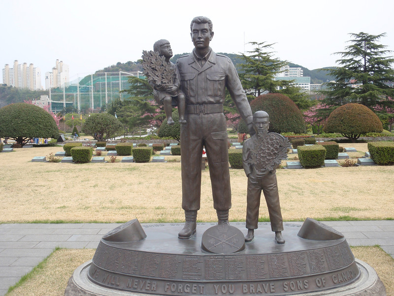 679_Busan City  UN Cemetery  Canadian Memorial Statue  Hatless, projects an air of individuality and informality jpg