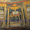 The gospel according to Saint Matthew open on an altar. Amcient UNESCO listed roman mosaic from the neonian baptistry, Ravenna, Italy