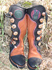 Whoohoooooooo!  Rockin' it in these fun boots! <br /> Tobacco Buffalo hide, with Black Organic Curve Button Trim, Redwood Deerskin Underlay, Black Deerskin Full Welt with Dome to Side, Green/Black Spiral Inset and Green/Redwood/Purple Peace Hand Inset, Antler Crown Buttons and Copper QuickSilver Buttons, Black Toe Caps, Cushi Midsole, Full Lug Vibram Soling.
