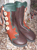 Jenny's boots are chocolate buffalo hide, with tobacco lotus flower button trim going up in points and curves.  They have a forest green underlay, and forest green natural edge flap.  The buttons are polished white antler sidecuts.