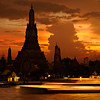 Wat Arun at sunset with boat trails