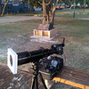 Setup ready for Partial Solar Eclipse, Broadbeach QLD - 14/11/2012 (Processed image)<br /> <br /> Sumsung SII phone camera image post processed with Adobe Photoshop CS5 to crop, colour and contrast adjust.<br /> <br /> Telescope - Apogee OrthoStar LOMO 80/480 with Hotech SCA Field Flattener, no filter, Canon 40D DSLR field 106' x 159' , Ambient temperature not captured. Mount - Inca camera tripod unguided.