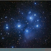 The Pleiades Cluster (M45) in Taurus is probably the most famous star cluster readily visible to observers in Winter.   It resembles a miniature Big Dipper.  Observers can readily see 6 bright stars and keen-eyed observers more.  There are 7 named stars in the group also known as The Seven Sisters.  A blue veil of nebulosity surrounds the brightest stars .  <br /> Image captured with AP130GT @ f/6.8 using an STL-11000M and LRGB filters (70;60;50;60min).<br /> By coincidence, the image of the Geminid Meteor Shower was captured the following night;  in that photo there are two meteors (faintly) visible in the frame along with The Pleiades.