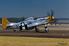 HILLSBORO, OR - AUG 4: Eddie Andreini demonstrates his P-51D Mustang during Oregon Air Show at Hillsboro Airport on August 4, 2012 in Hillsboro, OR.