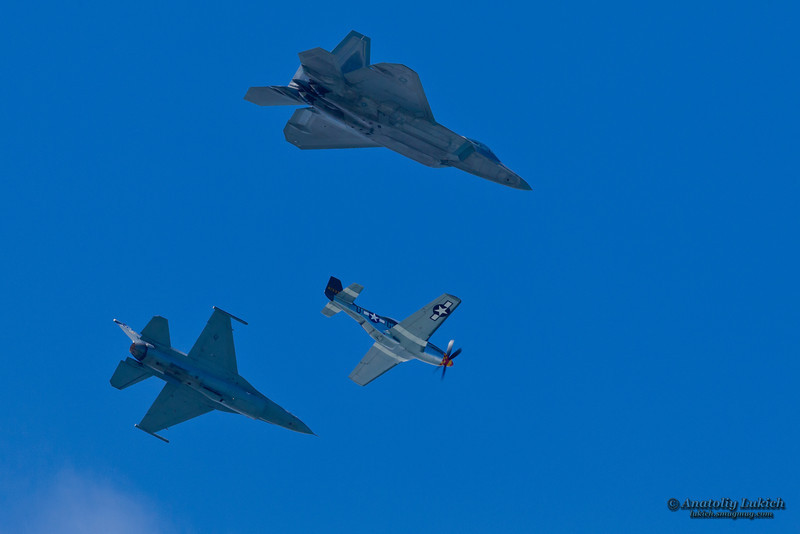 SAN FRANCISCO, CA - OCTOBER 7: P-51 Mustang World War II and modern F-16C Fighting Falcon and USAF F-22 Raptor aircrafts perform heritage flight during Fleet Week in San Francisco, CA on October 7, 2012
