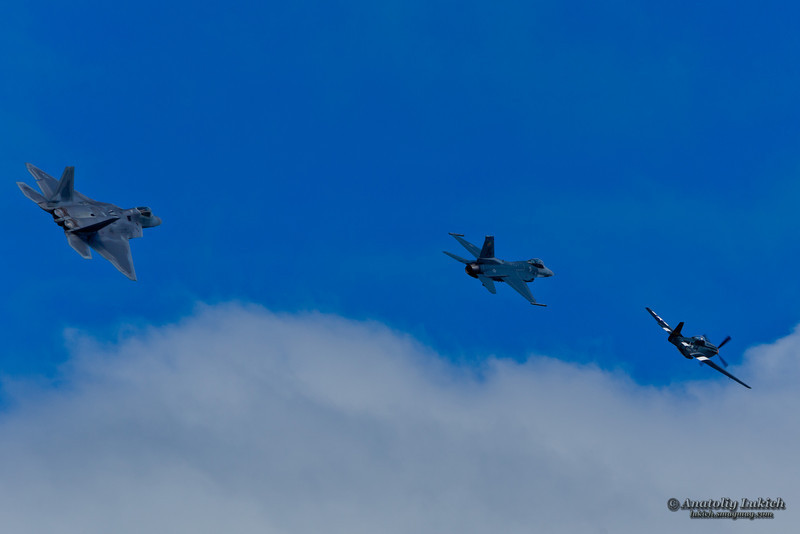 SAN FRANCISCO, CA - OCTOBER 5: P-51 Mustang World War II and modern F-16C Fighting Falcon and USAF F-22 Raptor aircrafts perform heritage flight during Fleet Week in San Francisco, CA on October 5, 2012