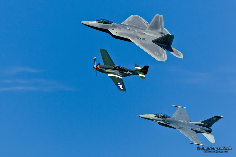 SAN FRANCISCO, CA - OCTOBER 6: P-51 Mustang World War II and modern F-16C Fighting Falcon and USAF F-22 Raptor aircrafts perform heritage flight during Fleet Week in San Francisco, CA on October 6, 2012