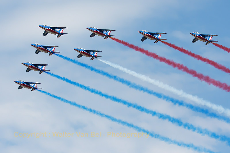 """The """"Patrouille de France"""", with 8 Alpha Jets, at the start of their display during the """"Meeting de l'Air 2014"""" at Base Aérienne 133 Nancy-Ochey. Alpha Jet ((E119; 7) is flying on the outer left side of the formation."""