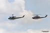 TACOMA, WA - JULY 21: Bell UH-1 Iroquois (unofficially Huey) and Bell AH-1 Cobra Helicopter Demonstration during Air Expo at McChord Field Joint Base Lewis-McChord on July 21, 2012 in Tacoma, WA.