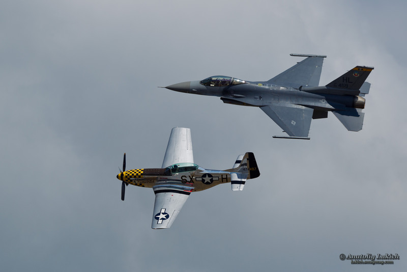 TACOMA, WA - JULY 21: P-51 Mustang World War II and modern USAF F-16 Viper aircrafts during heritage flight at the Air Expo at McChord Field Joint Base Lewis-McChord on July 21, 2012 in Tacoma, WA.
