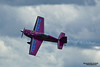 TACOMA, WA - JULY 21: Vicky Benzing in her purple Extra 300S demonstrate high performance aerobatics during Air Expo at McChord Field Joint Base Lewis-McChord on July 21, 2012 in Tacoma, WA