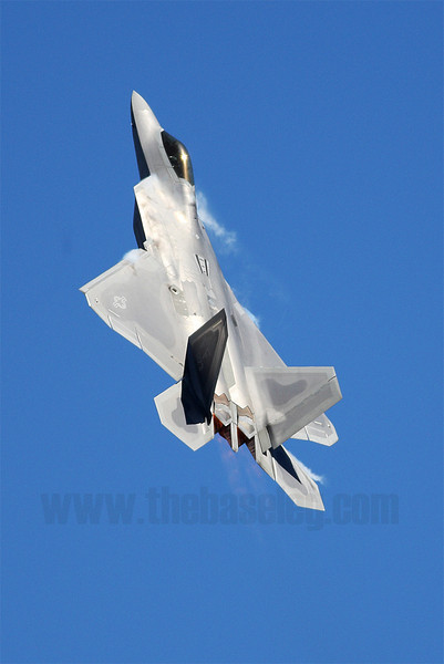 Vapour streams from the Lockheed-Martin F-22A Raptor during it's demonstration routine at the Avalon Airshow. Note the thrust vectoring nozzles in action, with the afterburner plume in a different plane from the rest of the aircraft.