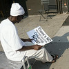 This man, a local storekeeper from Senegal, examines a sign.