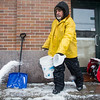 February 5, 2014 -  Valdir Dossontos throws salt onto a Commonwealth Ave. sidewalk in Allston, Mass. Photo: Carolyn Bick/BU News Service 2014.