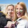 Boston, March 16, 2014 -- Brianna Sessa, right, and Michaela Barry, left, celebrate near Andrew Station at the St. Patrick's Day parade in South Boston. Photograph by Carolyn Bick. © Carolyn Bick/BU News Service 2014.