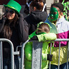 Boston, March 16, 2014 -- Parade-goers wait along the parade route near Andrew Station at the St. Patrick's Day parade in South Boston. Photograph by Carolyn Bick. © Carolyn Bick/BU News Service 2014.