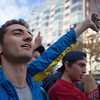 November, 2, 2013, BOSTON- A formal Boston Marathon runner(left), who refusers to give out his name, reacts to the the Red Sox World Series victory parade  near the Boston Marathon finish line. Photo by KIva Kuan Liu