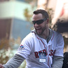 November, 2, 2013, BOSTON- Daniel Nava reacts the crowds when his duck bus in the Red Sox World Series victory parade crosses the Boston Marathon finish line. to Photo by KIva Kuan Liu