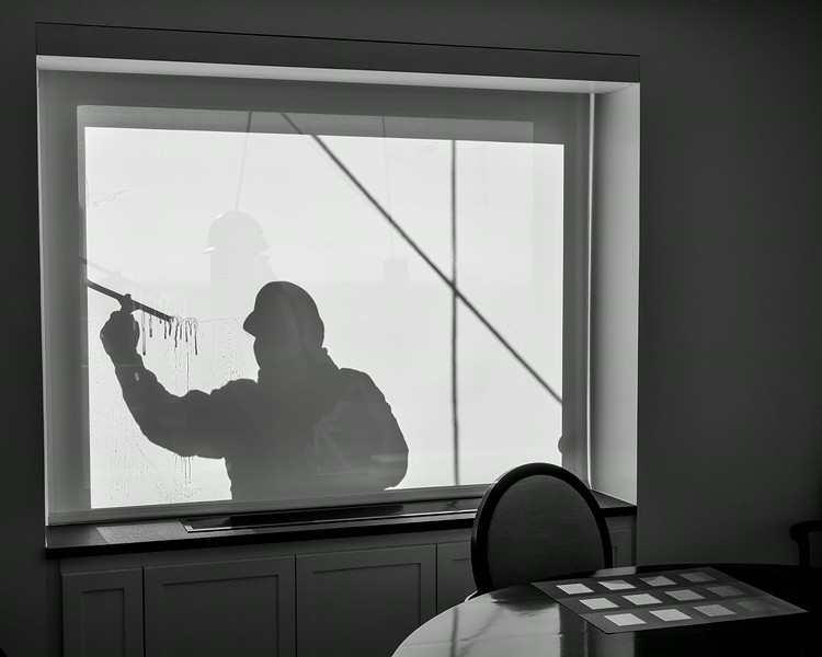 Window Washer silhouette 50 Sutton Place South NYC