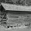 Rustic Log Storage Building
