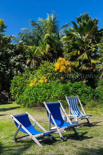 Loungers and tropical vegetation on the island of Caye Caulker, Belize.
