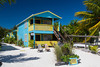 A colorful beach cottage on the island of Caye Caulker, Belize.
