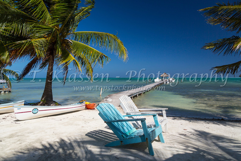 Boats and a pier on the island of Caye Caulker, Belize.