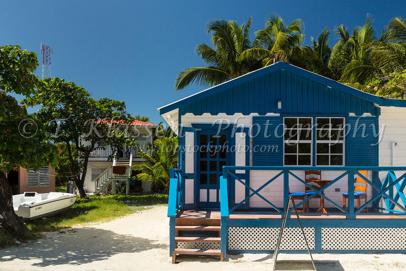A colorful beach cottage on the island of Cay Caulker, Belize.