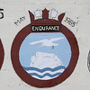 Crest of HMS Endurance at Dockyard, Bermuda. There have been two Royal Navy ships named HMS Endurance. The first (F171) was a British Antarctic ice patrol vessel between 1967 and 1991. The crest indicates that she visited Bermuda in May 1985.