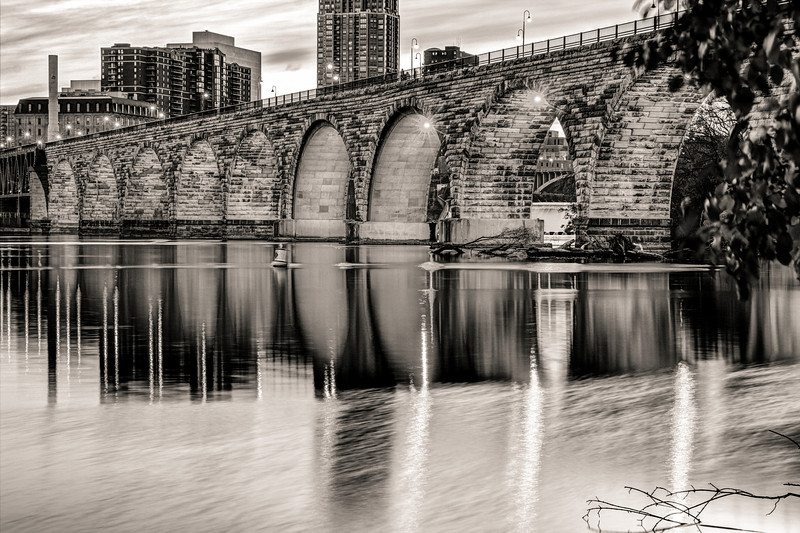 Arch Reflections in Black and White - The mirror-like Mississippi reflects the stone arches and streetlights in this twilight image.