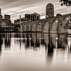 Historic Stone Arch Bridge - In Black and White.  The city seems takes on its original industrial character in this black and white view from across the river.