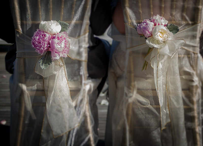 Rachael and Iain had Finishing Touches Flowers tie peonies and hydrangea to the back of seat covers to keep eye-level focus on the stunning views.