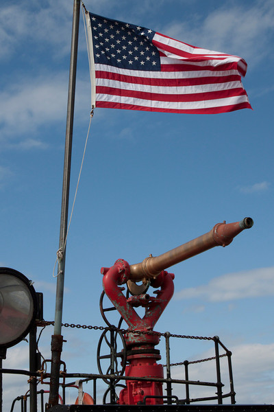 Flag and water cannon from the FDNY Fire Fighter docked in Greenport, NY for restoration.