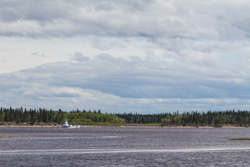 Ontario Northland barge Niska I approaching south end of Charles Island. Wide view. Barge will turn to enter channel on its way to Moose Factory.