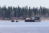 Two small tugs bring a Moosonee Transportation Limited barge down the Moose River back to Moosonee from Moose Factory.