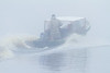 Robert Bluebioy's boat taxi heads off to Moose Factory on a foggy morning.