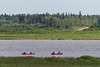 Paddle canoes on the far side of the sandbar from Moosonee.