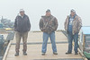 Boat taxi drivers on public docks in Moosonee on a foggy morning.