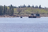 Two small tugs bring Moosonee Transportation Limited barge out of the Gutway from Moose Factory and back towards Moosonee.
