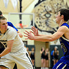 Longmont's Justinian Jessup, left, fouls D'Evelyn's Chase Cleary during the game at D'Evelyn High School on Saturday, March 2, 2013. Longmont lost to D'Evelyn 72-58. For more photos visit www.BoCoPreps.com. (Greg Lindstrom/Times-Call)