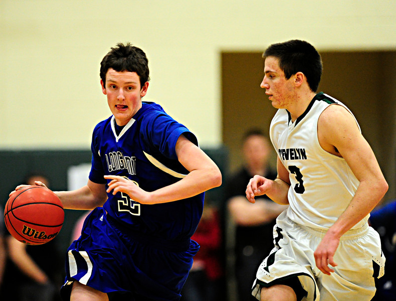 Longmont's Blake O'Grady (32) brings the ball up the floor against D'Evelyn's Connor Skelton (3) during the game at D'Evelyn High School on Saturday, March 2, 2013. Longmont lost to D'Evelyn 72-58. For more photos visit www.BoCoPreps.com. (Greg Lindstrom/Times-Call)